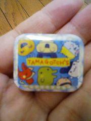 新品★TAMAGOTCH's□型の缶バッチ