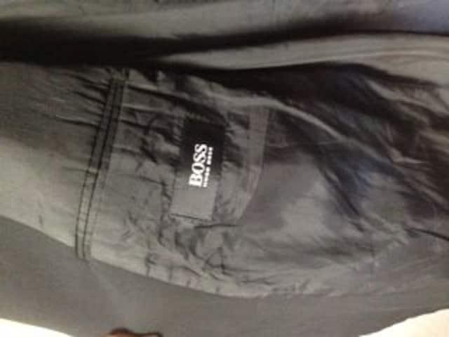 ヒューゴボスブラックジャケットXL < ブランドの