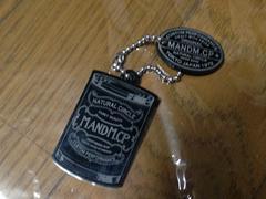 新品M&Mキーホルダー黒エムアンドエム缶詰